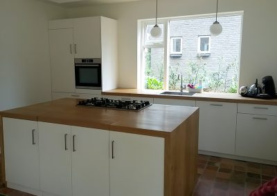 Dit keukeneiland biedt toegang tot de kelder